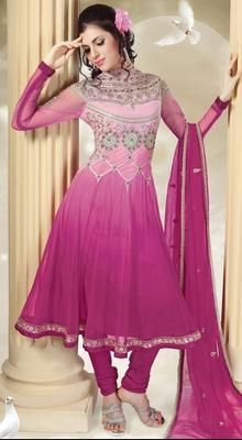 Magenta Embroidered Net Anarkali Suit   Let the stylish fashionista lying deep in your soul awaken with this magenta net Anarkali suit. Kameez features resham amd zari embroidered decorative patterns in the neckline till the waistline. Beautiful border with floral embroidered patterns completes the look. #ChuridarSuitsForWeddings #AnarkaliSuitOnlineIndia