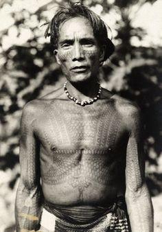 Philippines ~ Luzon Island | An ornately tattooed Kalinga chief and headhunter. | © Charles Martin / Vintage National Geographic