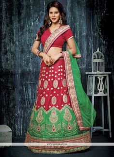 Genuine elegance comes out of your dressing style with this red net a line lehenga choli. The fantastic dress creates a dramatic canvas with unbelievable embroidered, patch border and zari work. Comes...