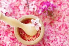 Welcoming in Spring: Spring Blossom Sensory Tub - Beautiful spring blossoms in a rice sensory tub. A simple spring inspired exploration.