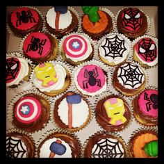Avengers and Spiderman themed cupcakes featuring The Hulk's fist, Captain America's shield, spiders, spider webs, Spiderman's face, Iron Man's face, and Thor's hammer