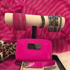 Wristlet/phone case Armani Exchange hot pink Wristlet/phone case used a total of once for about an hour perfect condition no flaws.👛 Armani Exchange Bags Clutches & Wristlets