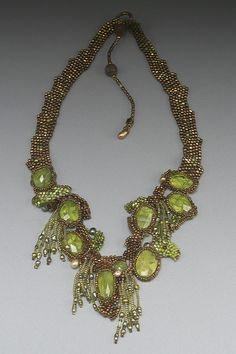 WILLOW'S SONG - perhaps the most beautiful piece by Amolia Willowsong. Freeform peyote beadwoven neckpiece with faceted peridot and Russian stitchtite cabochons, freshwater pearls and fine seed beads, fringed. Maybe my favourite freeform piece ever, if that's possible.