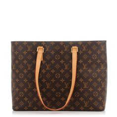 This is an authentic LOUIS VUITTON Monogram Luco. This stylish shoulder bag is crafted of monogram toile canvas. The bag features long vachetta shoulder straps and brass hardware. The top zipper opens to a spacious beige microfiber interior with zipper and patch pockets. Wear this bag with the chic style of Louis Vuitton!
