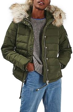 Black color size 6 Free shipping and returns on Topshop Woody Faux Fur Hood Puffer Jacket at Nordstrom.com. A puffy, channel-quilted jacket takes style notes from the Arctic and retro pilots with its plush faux-fur hood lining and shiny zip pockets.