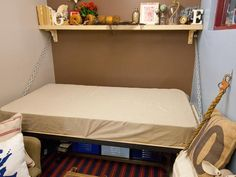 Fold-Away Beds: A Must for a Multipurpose Guest Room: Even in a tight space like this, nothing has to be moved to make room for the foldout bed. The bench with pullout cubbies stays right in place underneath the bed. (See the  previous slide.) From DIYnetwork.com