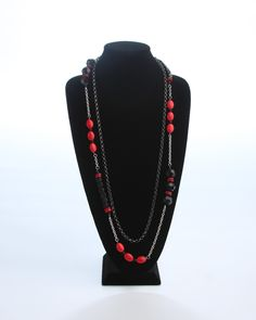 Vi Bella Jewelry - Flame Necklace - Red is making its comeback with a vengeance! The Flame Necklace consists of one long dark gunmetal chain, and one long strand of chunky black faceted beads, oval turquoise beads dyed red and silver chain.  Wear with the Flame Bracelet and earrings, and layer with the Flicker Necklace or Fire Necklace for a style that will really heat things up!     Length - 38 Inches      Handcrafted by Vi Bella Artists in Haiti.  $38.95