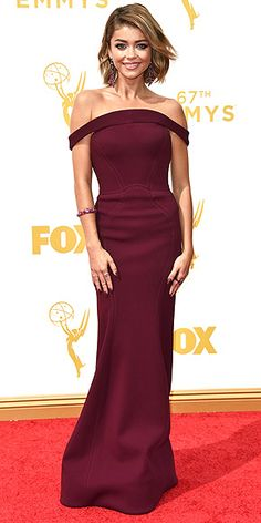 The Most Gorgeous Gowns on the Red Carpet at the 2015 Emmys | SARAH HYLAND | The Modern Family star's burgundy Zac Posen gown (worn with Lorraine Schwartz and Ofira jewels) has an unusual inverted neckline that drapes over her shoulder and open back.