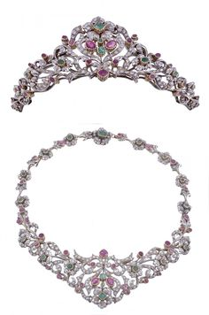 Scortecci ruby, diamond  emerald tiara/necklace c1961 - pierced scrolled floral design, w/8cut diamonds w/mixed cut rubies  emeralds, detachable tiara frame, plus floral  foliate link necklace back chain made of 5e removable sections to form bracelet either 16cm 0r 21cm, the bracelet/ back chain with 2 emeralddiamond cluster box snap clasps each signed Scortecci w/2 additional ruby  diamond leaf links, w/blue velvet bound Scortecci box