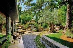 Rustic Garden by Javier Barba and Javier Barba in Ekali, Greece