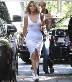 Casual footwear: Khloe kept it simple with her footwear and wore plain white sneakers...