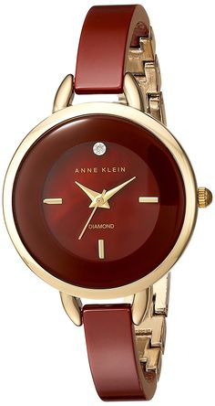 Anne Klein Women's Quartz Metal and Ceramic Dress Watch, Color:Red (Model: AK/2132BYGB) -- See this great watch.