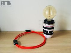 Handmade camera lens shape lamp.  It comes with a 170 cm long textil cord. The bulb is not included (E27, max 40w, 220V). Size: 8.3cm x 13.3cm  Can be installed with UK or EU plug. If you can not find your country, please inquire about the shipping conditions!  More lamps: