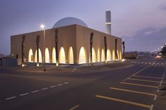 Arched openings in the sandstone facade of this Dubai mosque by Ibda Design lead worshippers into a bright marble courtyard with a textured minaret Mosque Architecture, Minimal Architecture, Sacred Architecture, Religious Architecture, Architecture Details, Beautiful Mosques, House Deck, Hindu Temple, Facade Design