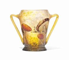 A DAUM FRÈRES 'CHAMPIGNON' ENAMELLED GLASS VASE WITH TWIN-HANDLES  CIRCA 1908  Price realised  GBP 5,250