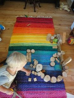#rainbow #rug and #natural playthings