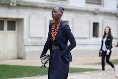 84 Outfit Ideas For Style Extroverts #refinery29  http://www.refinery29.com/2015/03/83675/paris-fashion-week-2015-street-style#slide-68  Dress up a corporate, navy suit with a bold chain.