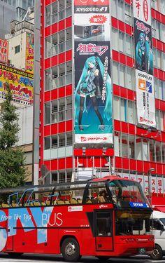 a sightseeing bus and Hatsune Miku at Akihabara