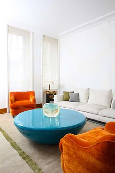 shots of bright complementary colours in a white living room, by CS Decoration