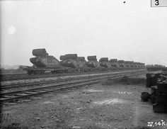 British Mark IV Female Tanks of 'C' Battalion loaded aboard a train at Plateau Station in preparation for the Battle of Cambrai. IWM | Flickr - Photo Sharing!
