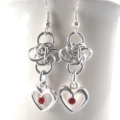 These sweet little chainmaille earrings are simple elegance. A single unit of Persephone is accented with a silver heart with your choice of