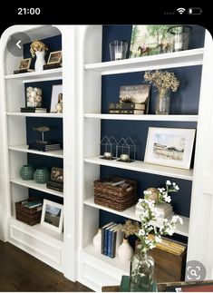 The blue's not bad without the glass doors/shelves. White built-in book shelves, navy paint from Built In Shelves Living Room, Bookshelves In Living Room, Bookshelves Built In, Book Shelves, Glass Shelves, Bookcases, Bookcase White, Paint Bookshelf, Painting Shelves
