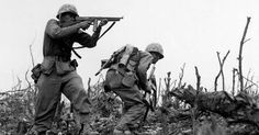 """""""A Marine of the 1st Marine Division draws a bead on a Japanese sniper with his tommy-gun as his companion ducks for cover. The division is working to take Wana Ridge before the town of Shuri. Okinawa, 1945. S.Sgt. Walter F. Kleine. (Marine Corps) Exact Date Shot Unknown NARA FILE #: 127-N-123170 WAR & CONFLICT BOOK #: 1228"""""""