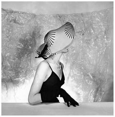 Model is wearing a hat by Jacques Fath, photo by Willy Maywald, 1953
