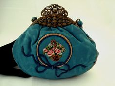 Unique hand made Victorian watered silk purse with ribbon design,late 1800's evening handbag on a brassy toned filigree frame, deep teal blue silk with embroidery and bow enhancement