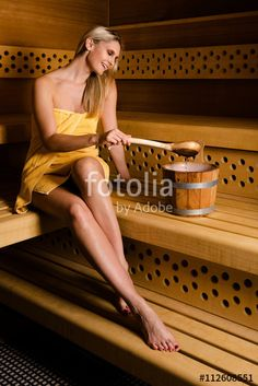 Gorgeous woman relaxing in sauna