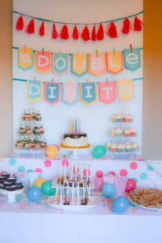A #doubledigits party fit for a 10 year old! Bright colors, chevron, homemade banners and more! Beverage table brought to you by Original New York Seltzer.