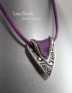 Handmade fine silver piece I made and added some purple suede to the back.  I stitched on the sterling chain around the edge.  Lisa Barth