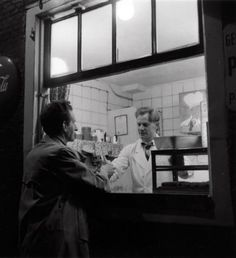 1953. Man buys french fries at a snackbar in Amsterdam. #amsterdam #1953