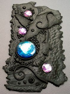 Black clay and candy wrappers WIP Journal cover by MandarinMoon, via Flickr