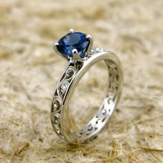@Katie RazunasNatural Blue Sapphire 14K White Gold Swirly Engagement Ring with Diamond Accent Stones - could be a diamond instead of sapphire