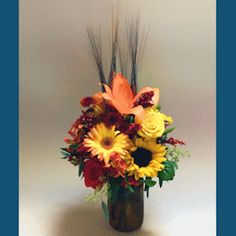 Matlack Florist - Fall Just Because A simple yet beautiful display of fall flowers, created in assorted colored fall mason jars. This is a smaller siz ...