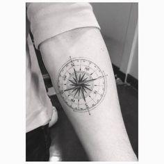 Fine line compass tattoo on Brooklyn Beckham's left inner forearm. Tattoo Artist: Dr. Woo