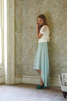 the worn wall paper plus pretty, feminine pastel wardrobe. love it!