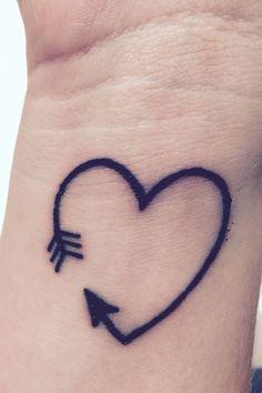 15 Amazing Arrow Tattoos for Females: #8. Heart Arrow Tattoo on wrist – A cute tiny heart tattoo for girls; #tattoos