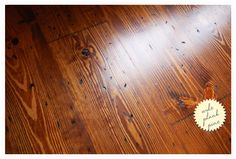 wide plank pine flooring - distressed and stained with tung oil. pine is a soft wood, so typically not ideal for floors, but it's cost effective and the distressed treatment will help camouflage future dings and scratches