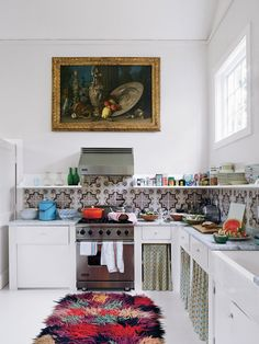 Carolina Irving - Marble counters and a farmsink.