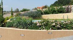 Pool on hillside with retaining wall and plants/ Medence domboldalban támfallal és növényekkel