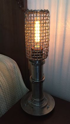Steampunk stainless steel Edison cage lamp repurposed from cannery pipe fittings