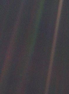As the Voyager 1 left the solar system Carl Sagan convinced NASA officials to turn its camera around and take a picture of the solar system. The image that was taken is the famous blue pale dot. This is the farthest any object from Earth has ever been. Carl Sagan, Ali Michael, Pale Blue Dot, Space Probe, Closer To The Sun, Earth Photos, Science Photos, Maya Angelou, Civil Rights