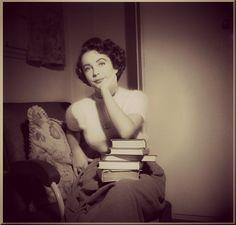 Elizabeth Taylor with books