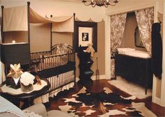 Gender neutral baby room. Not crazy about the cow skin but I like the changing table in the closet!