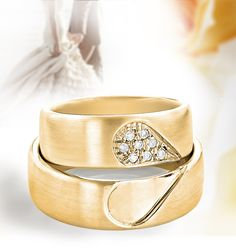 This Matching His and Hers Wedding Band Set 14K Gold Comfort Fit Rings showcase intricate design and 0.1 carats of round diamonds and featuring a unique heart design. Beautiful matching diamond bands featuring a unique design available in 14K white, yellow and rose gold.