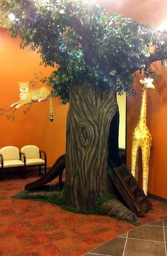 If you're looking to spruce up your medical or dental office waiting room, you've come to the right place! Kids will practically be begging their parents for a visit to the doctor& Tree Bedroom, Forest Bedroom, Preschool Jungle, Kids Stage, Jonah And The Whale, Jungle Tree, Fake Trees, Toddler Playroom, Giant Tree