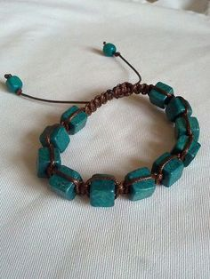http://www.ebay.co.uk/itm/Genuine-NEW-handmade-Shamballa-friendship-BRACELET-green-blue-beads-brown-cord-/181055457759?pt=UK_JewelleryWatches_WomensJewellery_Rings_SR=item2a27bf09df