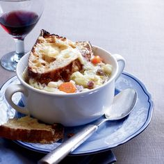 White-Bean-and-Ham Stew | This hearty stew called garbure, from southwestern France, is loaded with vegetables, beans and meat, the exact ingredients depending on availability. Jacques Pepin's version includes ham hocks and cabbage and is topped with toasted bread smothered in melted Gruyere cheese. Traditionally, anyone eating the stew would add some red wine to the last few spoonfuls of broth and sip it straight from the bowl.